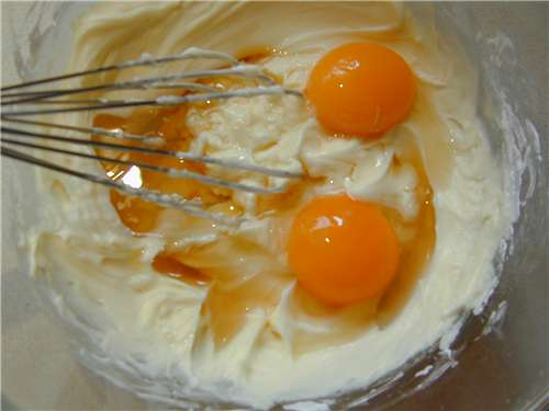 Mascarpone and sugar, egg yolks, and the liqueur