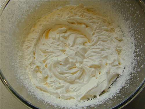 The finished whipped cream, looking glossy and stiff